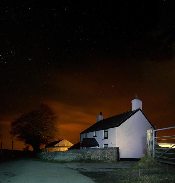 Old farm house under a night sky by cfreeman