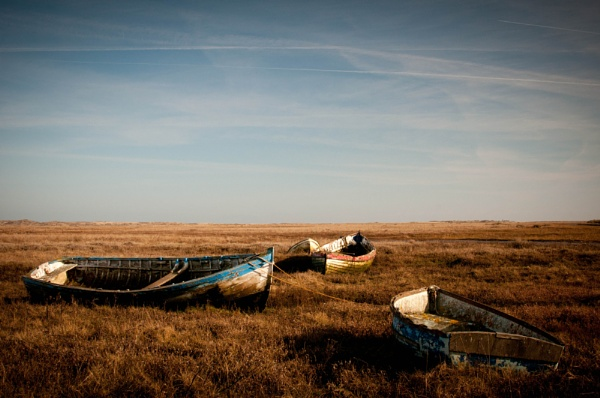 Boats near Brancaster, North Norfolk by Putnam