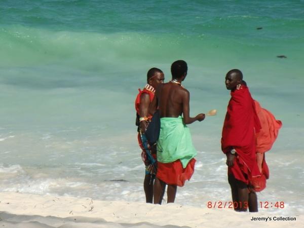 Three Samburu Warriors gassing on the Diani Beach