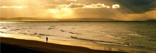 Lone jogger, Moray Firth by mgts24