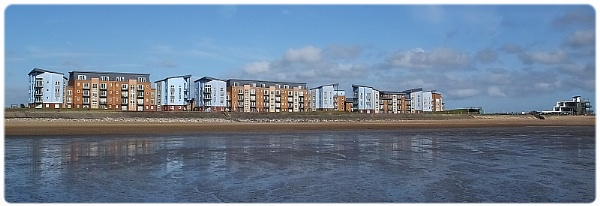 wide angle of beach and the buildings in llanelli beach by paulmanneringphotos