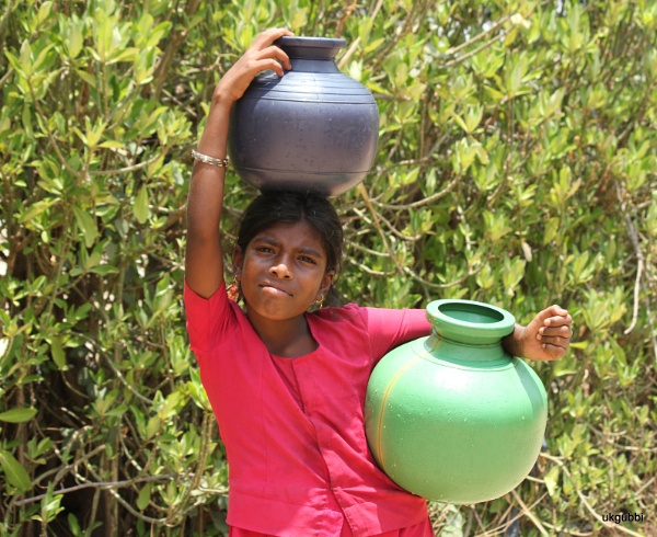 young girl iwth pitcher by ukgubbi