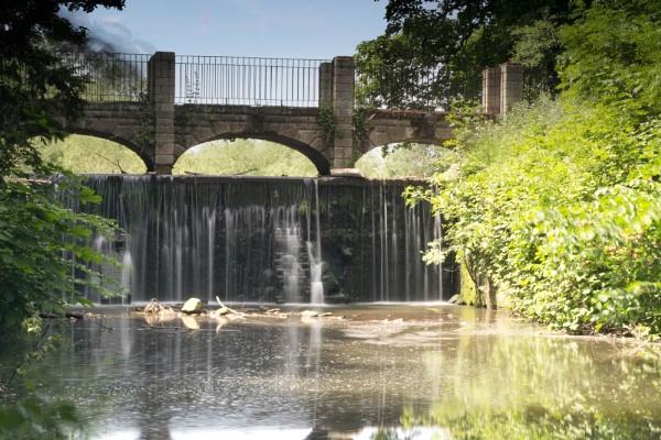 Bridge over waterfall by Fearny