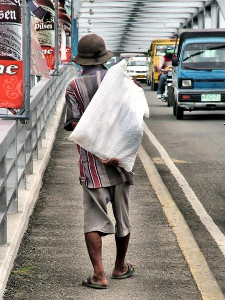 Old Man Walking - Mactan Bridge Cebu by Hamlin