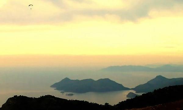 Dusk paraglider over Olu Deniz by Twin2Devine