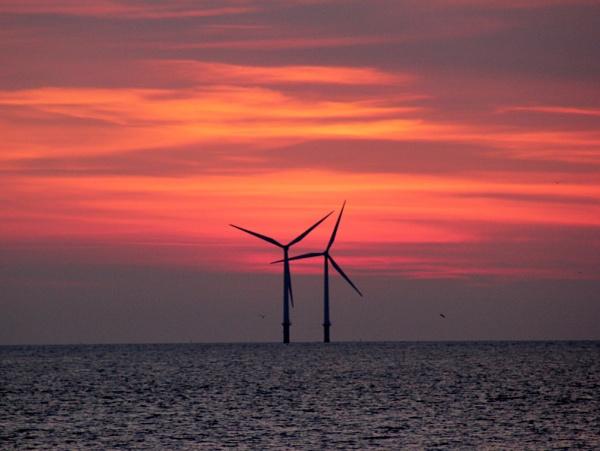 Solar vs Wind Power by EyesFront
