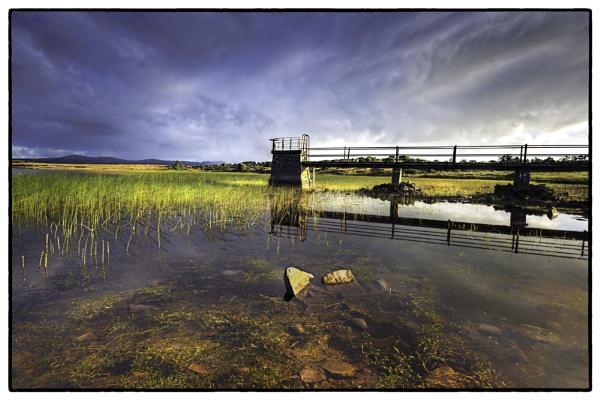 Bridge over peaceful waters by ANNIEKERR