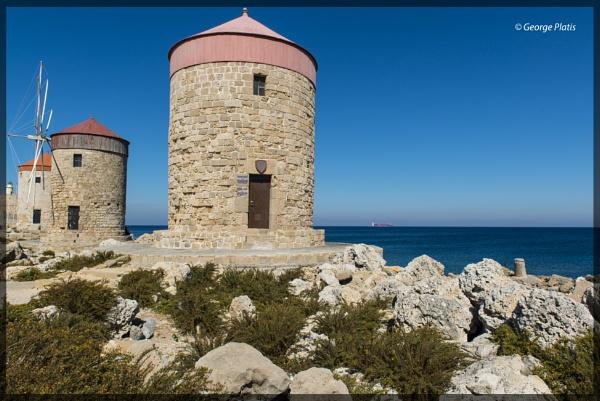 Medieval Windmills at the harbor of Rhodes town by GeorgePlatis