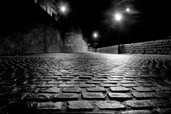 Street-lit cobbles by adonoghue