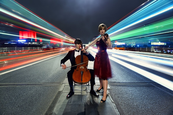 Violinist & Cellist Performing in Traffic by Anatoleya