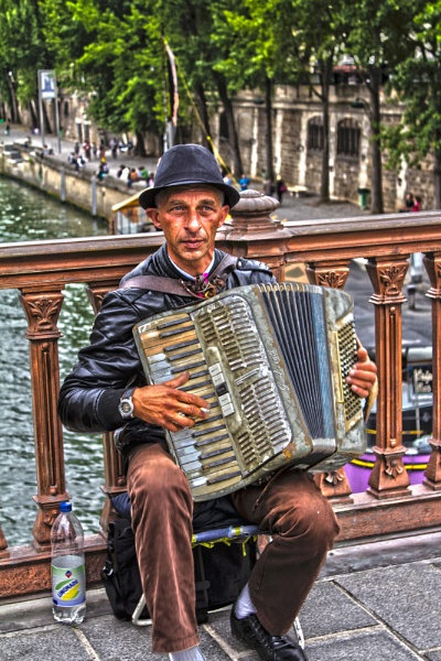 Accordion player at Notre Dame by WorldInFocus