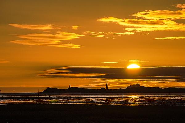 Sunrise over Bamburgh by icphoto