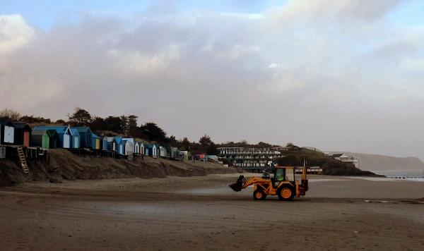 He\'s building a big Sand Casstle by netta1234
