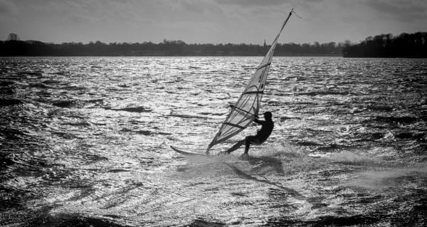 Sunday Shadow Surfer Skimming Skillfully by termite53