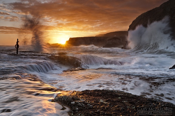 Sunrise at Ballintoy by garymcparland