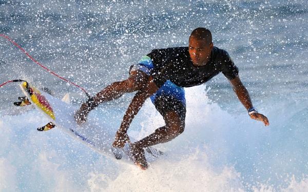 Surfer doing a grab-rail reverse. by steevo46