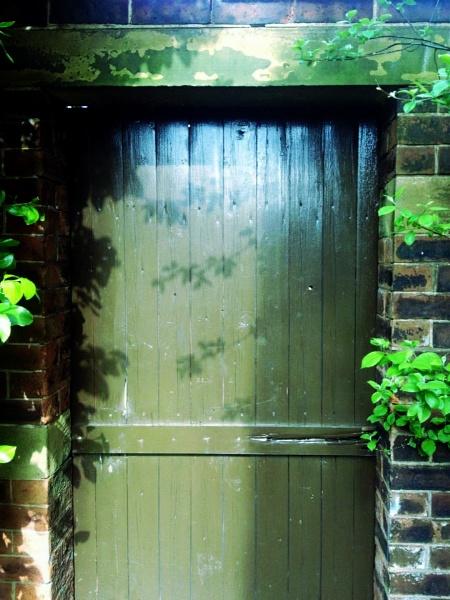 ancient doorway into walled garden by quick
