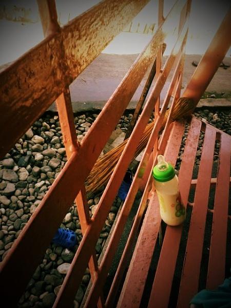 bottle on a bench. by aerjeff