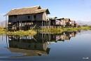 Neat rows of stilt houses on Inle Lake Myanmar by Benlib