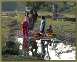 Washing utensils and clothes at a running stream...