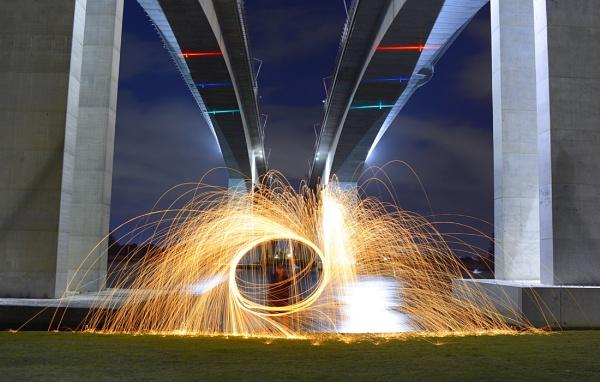 Fire-twirling under twin bridges by steevo46