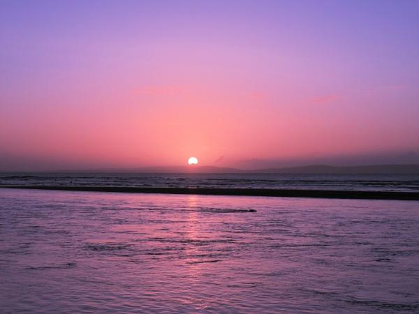 Sunrise over the island by steve_i