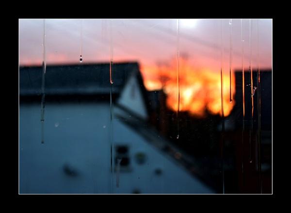 Sunset through Streaky Windows by helenlinda