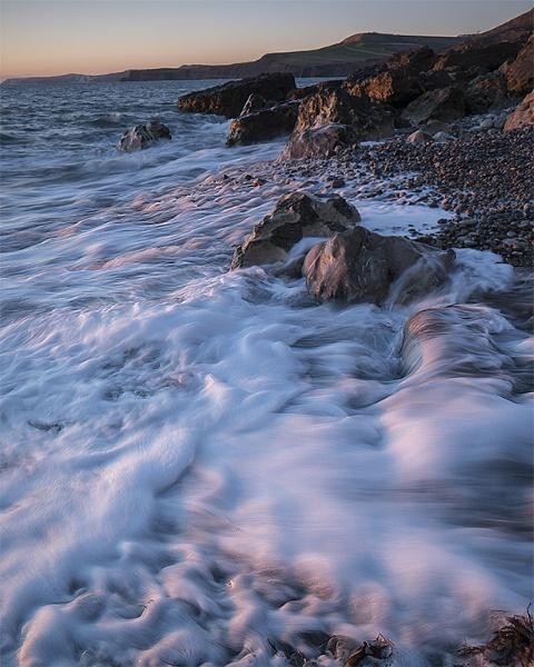 Last light at Pier Bottom, Dorset, slow shutter speed by seandhlewis