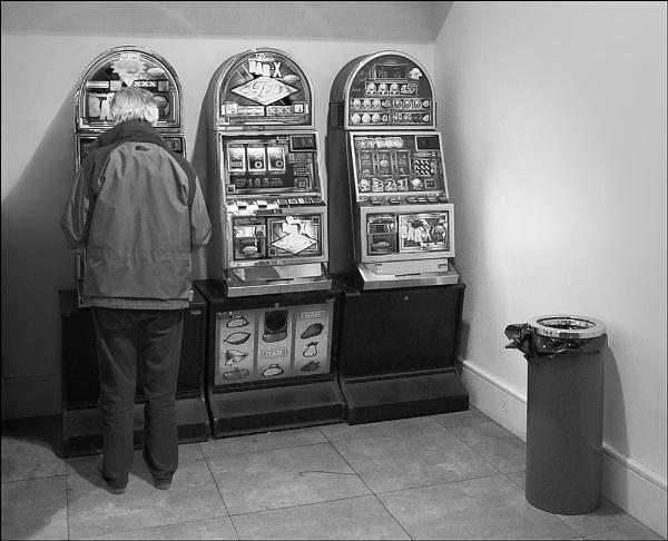 Solitary Gambler by Otinkyad