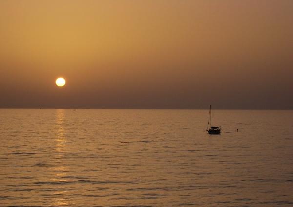 Sailing at sunset by jimobee