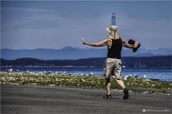 Beach Balancing Act by Daisymaye