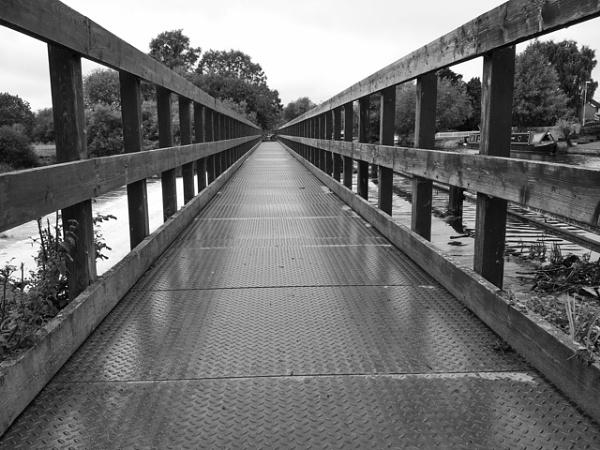 Narrow footbridge by aazzaa