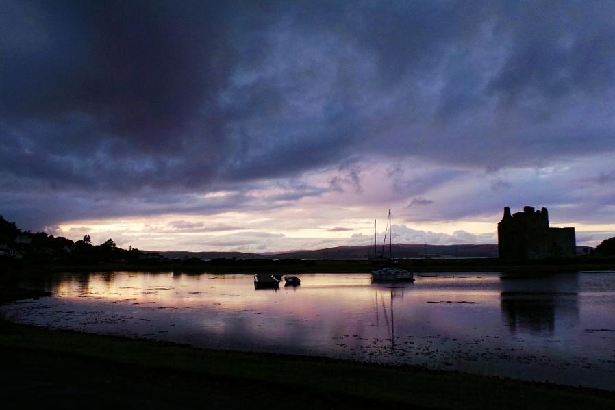 Moody evening sky over Lochranza and castle (Arran)