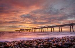 Pebbbles, Sea and Pier Sunrise