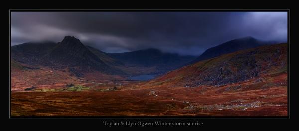 Tryfan & Llyn Ogwen at Winter  sunrise  storm. by J_Tom
