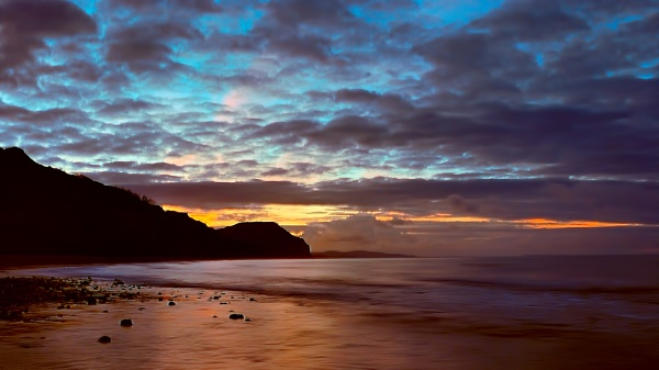 sunrise over charmouth dorset by lesvictor