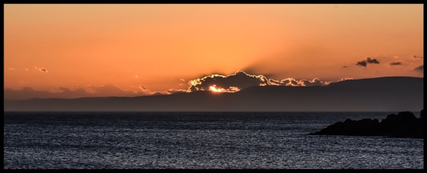 Sunset over the ocean by ColleenA