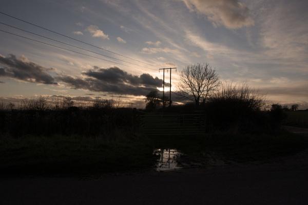 sunset reflected by magicman