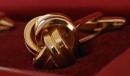 Gold knot cufflink