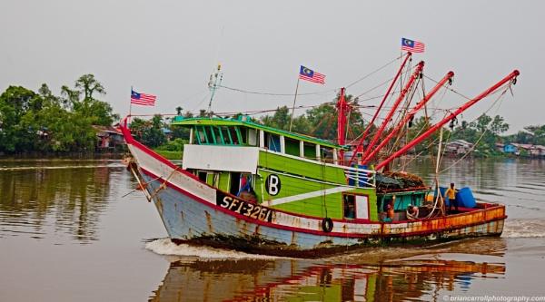 Fishing boat on the Sarawak River, Kuching, Sarawak, Borneo by brian17302