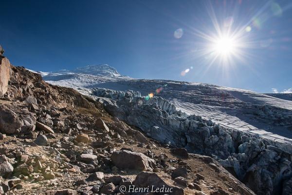 Sun flare & Cayambe summit by macxymum