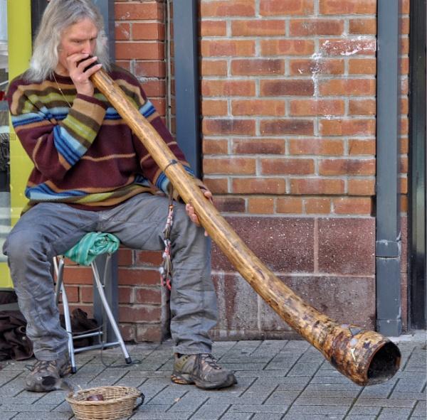 Didgeridoo player by ANNDORASBOX