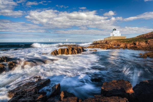 Bamburgh lighthouse, Northumberland, England. by fletchphoto