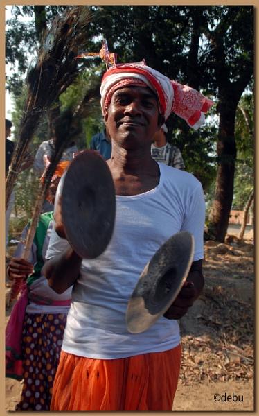 Santhal man playing the brass cymbals... by debu