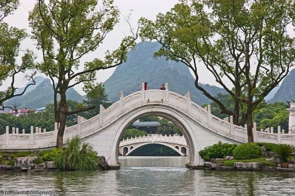 Bridges over the River Li at Guilin, Guangxi Zhang region, Southern China by brian17302