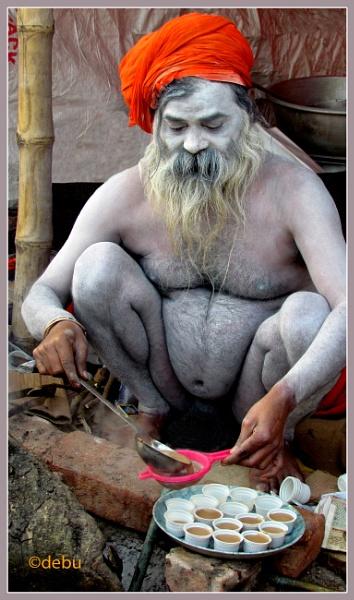 Ash painted holy man preparing tea... by debu