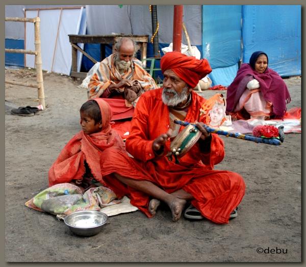 A Sadhu Baba playing Indian musical instrument by debu