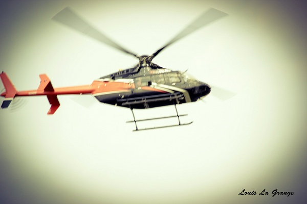 HELICOPTER IN FLIGHT by LouisC
