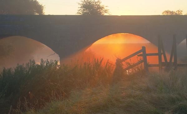 sunrise under bridge by stuart1963