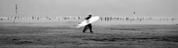 Surfer leaving the beach